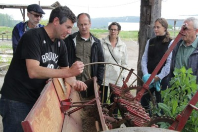Dan Hulse demonstrates the workings of a 100 year old seed drill